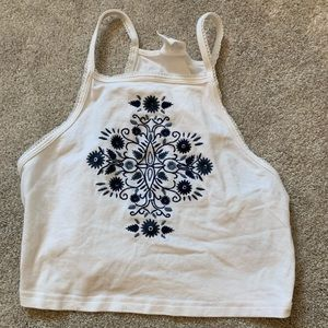 White and blue flowered cropped top